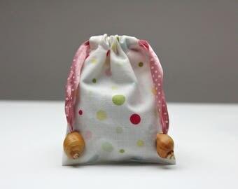 Pebble Pouches (Polka dot print). Drawstring cotton bags with natural shell toggles.