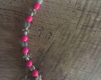 Fuschia pink cross bracelet