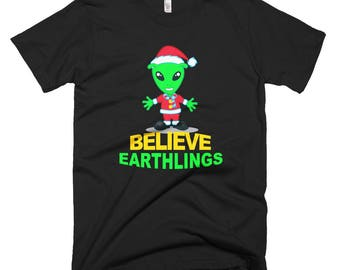 Believe Earthlings Shirt // Funny Christmas Alien T Shirt // UFO Space Shirt // Holiday Alien Shirt // Gift For Him Short-Sleeve T-Shirt