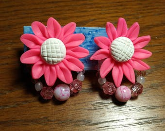 A pair of polymer clay earrings and glass beads