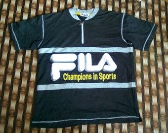 Rare vintage 90's fila sport big logo spell out shirt