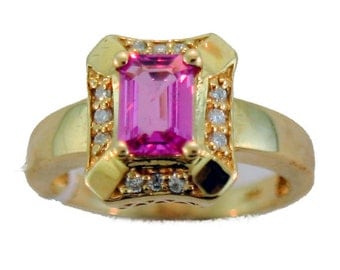 Pink Sapphire and Diamond RIng set in 14k Gold.