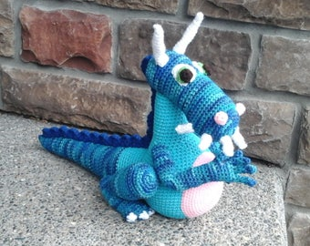 Hand crocheted dragon toy