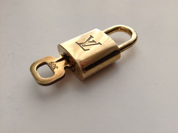 Authentic Louis Vuitton lock and key #309