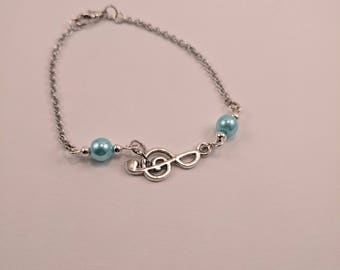 Silver Treble Clef Bracelet with Blue Pearl Accents on Silver Chain