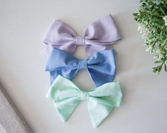 Large and Extra Large Solid Colored Schoolgirl Bows on Headband or Clip