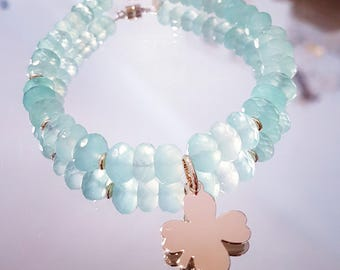 Bracelet in blue-green chalcedony faceted aqua beads in 9 k gold and silver plated clover pendant