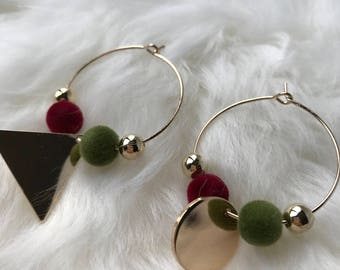 Hoop earrings with red and green pompoms