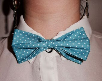 turquoise bow with white polka dots