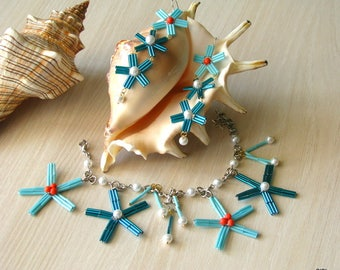 """Bracelet and long earrings """"Sea"""" set of glass beads with corals and pearls."""