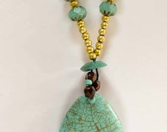 Glass beads with turquoise pendent
