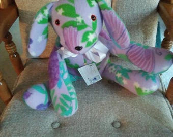 Puppy for baby nursery in multicolor fleece on lavender background. Hypoallergenic stuffing. Safety eyes n nose. Measures 15 long.