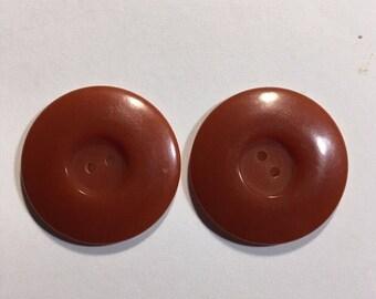 Two vintage butterscotch bakelite buttons