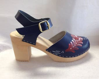 Navy blue Mary Jane on a natural Super High Heel with buckled ankle strap and red painted kirbits