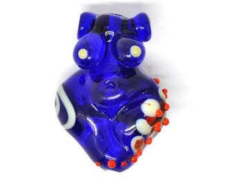 Transparent blue and white, red dotted Goddess bead