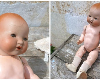 Antique bisque head doll  Armand Marseille dream baby body  composition body/ with bonnet & shoes