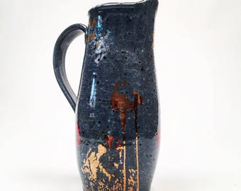 Poppy pitcher with glossy black glaze and copper decals