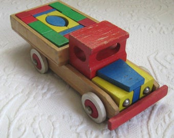 toy truck . wood truck . wooden truck with blocks . wood toy . heros wood truck . heros . heros wood toy