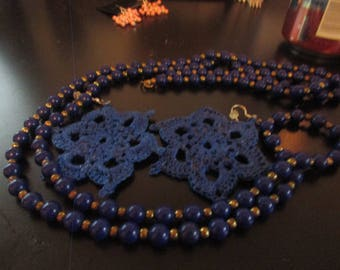 blue flapper beads with dollie