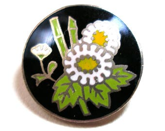 """50s Enamel BUTTON, Japanese flowers in white, yellow with green bamboo on black. 5/8"""", Made in Japan."""