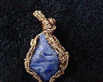 Raw sodalite wire wrapped pendant