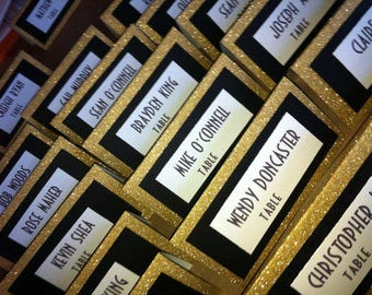 Shimmering gold and black placecards for Gloria