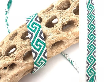 Friendship bracelet - spiral pattern - embroidery floss - knotted - woven - white - green - braided - string - thread - cotton - handmade