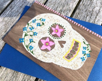 Hand-Painted Wood Greeting Card Sugar Skull in yellow, white, pink, blue, with walnut wood shining through.