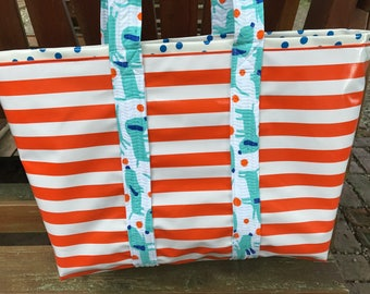 Yipes stripes funky oilcloth tote bag in orange and white