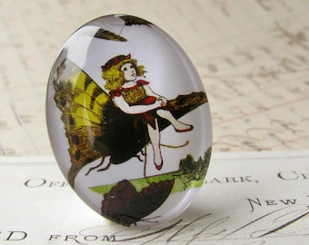 Fairy riding her butterfly, handmade 40x30 40x30mm  glass oval cabochon, fantasy stories, Victorian children's books, white, yellow