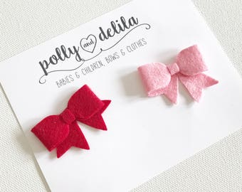 newborn or baby stick on bows-red and pink