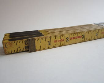 vintage folding ruler - 57 inches as is  - metal and wood - CRAFTSMAN folding ruler - industrial wooden folding rule