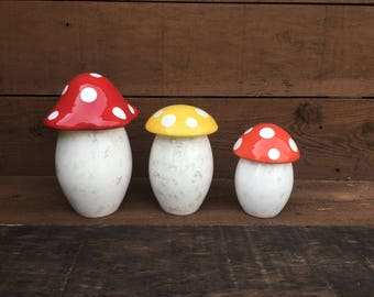 Set of Three Bright Colorful Mushroom Canisters in Red, Orange, and Yellow