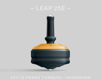 LEAP 25E Yellow-on-Black Spin Top with yellow cover over black body, ergonomic stem with rubber grip, dual ceramic tip, and 3 accent holes