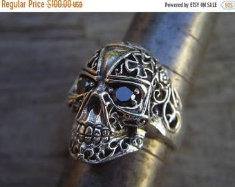 ON SALE skull ring made in sterling silver with black cz's in the eyes