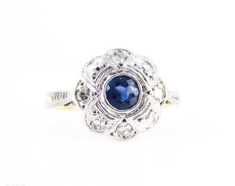 Vintage Sapphire & Diamond Daisy Engagement Ring, Blue Sapphire in Floral Shape with Milgrain Beading. Circa 1920s, 18ct Platinum.