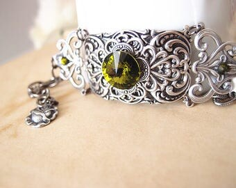Kavita--Swarovski oliva green crystal antique silver brass Victorian adjustable bracelet