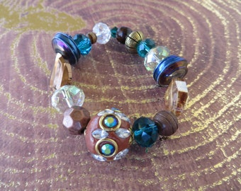 Stretchy Chunky Beaded Bracelet With Blue And Bronze Tones