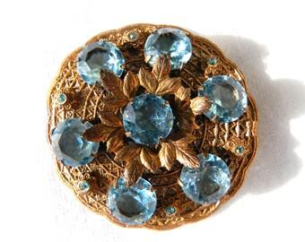 "Antique Art Nouvea Etched Leaves Gold Filigree Blue Rhinestone Brooch - Sash Pin - Blue Glass Topaz December Birthstone - Huge 2 1/4"" Round"