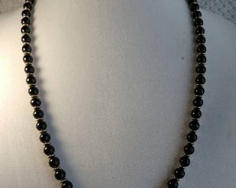 Vintage 26 inch Single Strand Necklace of Black Acrylic Beads with Bronze Spacers