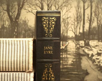 Jane Eyre book by Charlotte Bronte bound in dark blue faux leather