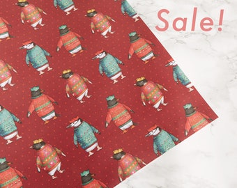 Penguin Parade Wrapping Paper: Birds in Hats Penguin in Christmas Jumpers Wrapping Paper