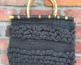 Green crochet purse with wooden handles