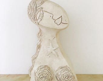 Girl wearing Her starfish Necklace Clay Sculpture