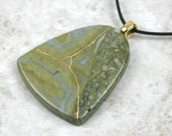 Kintsugi (kintsukuroi) Australian green lace jasper flag-shaped stone pendant with gold repair on black cotton cord - OOAK