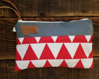 Canvas clutch/Red and white triangle print/Gray canvas/Caramel vegan leather details/White zipper