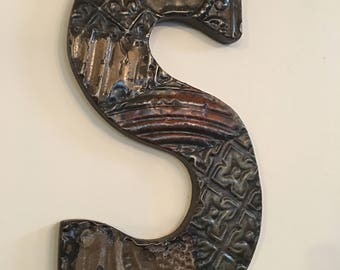 """Patchwork letter """"S"""" designed with antique tin ceiling tile"""