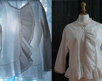 Antique flounced blouse, white cotton, small laces.