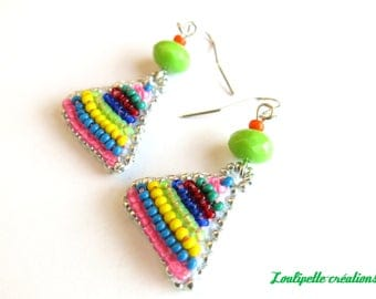 Earrings are made of embroidered