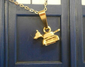 Gold K9 charm pendant